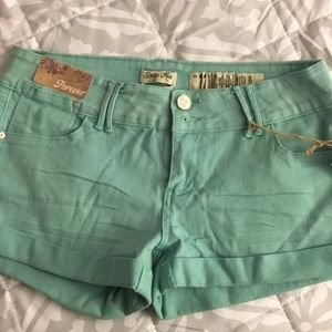 Teal jean shorts